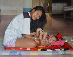 the joy of motherhood (the foreign photographer - ) Tags: young woman mother seated floor front room baby mat khlong lard phrao portraits bangkhen bangkok thailand nikon d3200