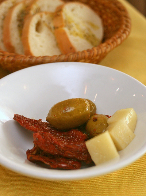 Welcome basket of bread includes olives, sundried tomatoes and cheese!