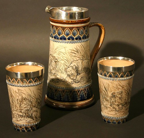 A jug and two beakers by Doulton Lambeth, decorated with pictures of lions by the renowned artist Hannah Barlow