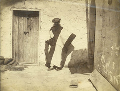 Edward H Palmer wearing Arab costume in the courtyard of a house in Jerusalem (possibly). (Palestine Exploration Fund) Tags: portrait man costume jerusalem scene 1870 tyrwhittdrake gibsonvitto desertofthetih PEF:photo=p1475 palestinejudeadistrict