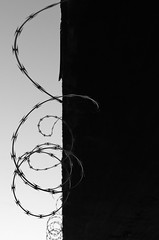 Wired (Damon D. Edwards Photography) Tags: bw abstract art lines la interesting louisiana industrial unique creative cajun coils razorwire notrespassing urbanexploring ue keepout coiled redstick thedeepsouth landscapephotography batonrougela cajuncountry coonass nikonblackandwhite apassionforthepacificnorthwest damondedwards