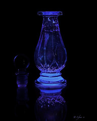 Aglow (S_Freer) Tags: blue reflection mirror bottle nikon glowing onblack 100photos 018100 d7000 44100 glowstickjuice 100possibilities