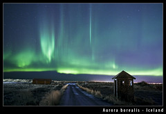 Aurora borealis - Iceland (Arnar Bergur) Tags: road green tower night barn canon lights iceland aurora citylights northern sland borealis 24mm14l canoneos5d norurljs lftanes