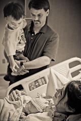 IMG_1341Lg.jpg (JonathanNutt) Tags: family boy blackandwhite bw closeup sepia kids hospital children parents kid model toddler infant waiting alone child emotion