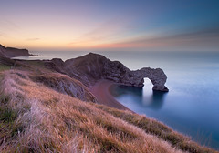 Pre-dawn at Durdle Door (Alistair Haimes) Tags: world uk sea england west heritage water sunrise landscape dawn bay coast site nikon britain path cove south great nopeople calm unesco coastal dorset nikkor predawn seaview lulworth tranquilscene durdledoor 1735 jurassiccoast southwestcoastalpath southwestcoastpath f28d manowarbay d700 coastuk alistairhaimes gettyimagesuklocation welcomeuk