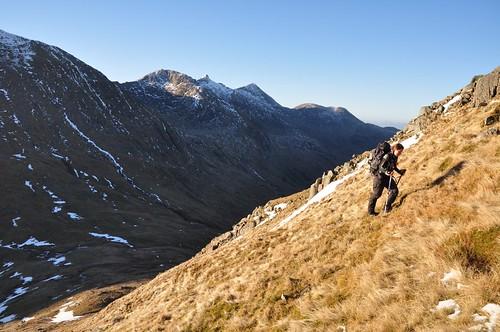 Nathalie Climbing Beinn a' Chochuill, overlooked by Ben Cruachan