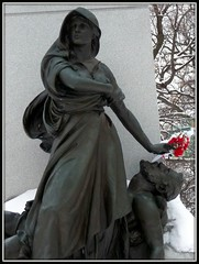 Roses for the martyrs (yooperann) Tags: flowers roses monument cemetery grave statue plastic haymarket martyrs forestpark anarchists chicagoist waldheim
