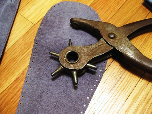 Pre-punching the slipper sole holes