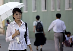 North Korea beauty in Pyongyang (Eric Lafforgue) Tags: woman color colour cute girl beauty horizontal nice war asia outdoor korea asie jolie dailylife coree fille couleur northkorea 0604 axisofevil pyongyang dictatorship dprk coreadelnorte stalinist beaute traveldestinations exterieur northkorean viequotidienne nordkorea dictature traveldestination democraticpeoplesrepublicofkorea    coreadelnord  encouleur coreedunord axedumal rdpc  insidenorthkorea  rpdc  nordcoreenne kimjongun coreiadonorte  umbrellaheat