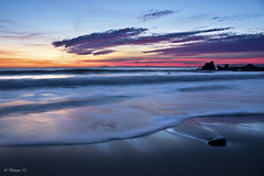 The Lee of the Stone (Didenze) Tags: longexposure light sunset sky orange seascape clouds catalina sand rocks glow purple smooth silhouettes wave explore frontpage coronadelmar canon450d didenze