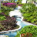 Enjoy the meandering pools set in lush, tropical gardens.