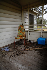 Chair and trash on front porch (peterlfrench) Tags: ranch abandoned trash rural vintage lost chair nikon texas january coastal forgotten porch refugio frontporch southtexas ranchlife 2011 thirdcoast emptychair d700 dsc6685 refugiotexas pfrench99 peterlfrench