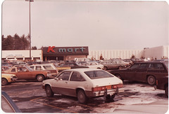 AT K MART IN 1982 (richie 59) Tags: city building cars chevrolet film car america 35mm buildings outside 1982 automobile gm kingston chevy chrome newyorkstate oldcar 1980s oldcars coupe automobiles taillights taillight stationwagon olddays hatchback chevys nystate citation americancars japanesecars generalmotors hudsonvalley kingstonny whitecar whitecars 2door motorvehicles ulstercounty oldchevy twodoor 4door hudsonvalleymall uscar uscars stationwagons midhudsonvalley americancity fourdoor japanesecar ulstercountyny