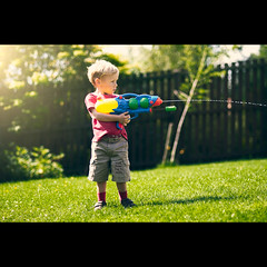 Shoot! (PMMPhoto) Tags: family blue boy shadow red portrait green water grass yellow garden paul nikon photographer glasgow  mcgee 85mm lifestyle pistol hamish nikkor 18 d300 lanarkshire strathaven paulmcgee donotusewithoutpriorpermission summertimeuk pmmphoto paulmcgee
