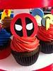 Superhero Cupcakes (Jenny Burgesse) Tags: cupcakes superhero fondant deadpool geeksweets comicbookshoppeartgala2010