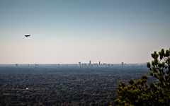 Atlanta Skyline - Photographed from Stone Mountain (mjkjr) Tags: park atlanta sky fall skyline canon ga landscape rebel availablelight atl windy blimp airship atlantaskyline dslr monolith stonemountain 70200 metroatlanta dirigible telephotolens 2010 flyby 500d potn october30 kennesawmountain atlantafromabove derrigible ef70200mmf4lusm t2i mjkjr october302010 httpwwwflickrcomphotosmjkjr suntrustblimp fullatlantaskyline atlantaskylinephotographedfromstonemountain detailedatlantaskyline