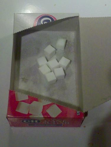 8 sugar cubes in a box