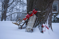 Christmas Sleds (Matt Champlin) Tags: life christmas old holiday snow history rural landscape evening candles peace snowy country joy sledding bows sleds skaneateles christmasscenes skaneateleschristmas oldtimechristmas gettyholiday2010
