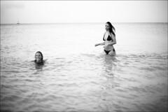 frolicking (gorbot.) Tags: sunset blackandwhite bw beach alice f14 palermo roberta mondello canoneos5d nikonfmount planar5014zf carlzeisszf50mmplanarf14 eosadaptor