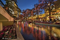 Riverwalk Christmas with Tiny Moon (Ellen Yeates) Tags: christmas bridge winter vacation moon holiday reflection tree water night sanantonio dinner canon river boat ellen san long exposure texas bokeh under scene tourist palm trail tiny resturant antonio dri hdr buidling yeates umberlla theriverwalk