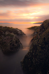 Inversion (Spencer Bowman) Tags: longexposure light sunset sea mist seascape silhouette coral fog coast scotland rocks dusk deep coastal valley inversion depth ayrshire portencross nd110 km1735 minolta1735 bwnd110 sonya450