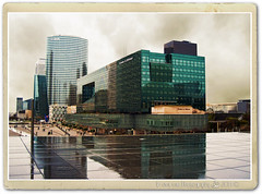 Il pleut sur La Defense (in eva vae) Tags: city blue paris france texture glass rain architecture modern clouds photoshop vintage reflections warm eva nuvole cityscape place skyscrapers kodak framed postcard peach ladefense piazza colori pioggia citt digitalcameraclub grattaceli 100commentgroup inevavae