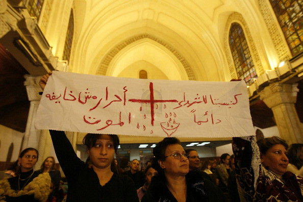 "Banner reads ""Our church is always   for martyrs, free people not afraid of death."" (Photo: Mohammed Abed/AFP/Getty Images)"