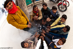 Cold Delhi (Popeyee) Tags: temp pictures street morning travel winter people india news cold men boys weather misty fog fire photo smog hands flickr gallery sitting foto photographer image photos jan pics delhi north january foggy picture documentary freezing wave social scene snap images bonfire fotos latest chilly around indians temperature bild winds chill warming bilder colder journalist shivers 2010 reportage degrees photojournalist 2011 popeyee popeyeeflickr