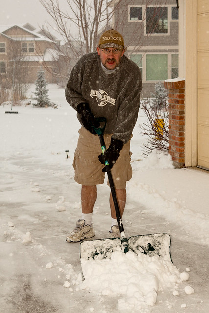 Shoveling snow in shorts and sneakers