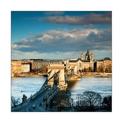 Januri Budapest (Botond Horvth) Tags: city travel bridge winter white house cold color season nikon europe cathedral weekend budapest chain filter transportation nikkor duna danube magyarorszg lnchd cokin 2011 d90 botond horvth rakpart 1685mm builndig