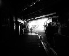 23/365: Tunnel (joyjwaller) Tags: blackandwhite men history bicycle japan sketchy dark tokyo tunnel dim pilgrimage shimbashi yamanoteline yamanotesen project365