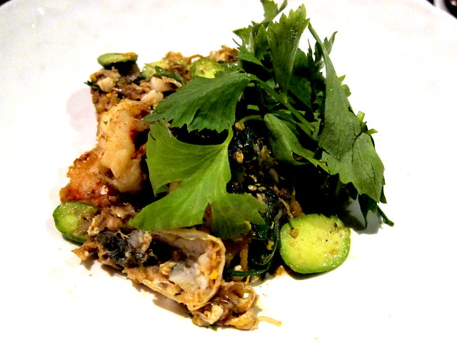 Pad gung sai sator gratiam dong lae cha-om (Stir-fried prawn with sator bean pickled garlic and acacia leaves)