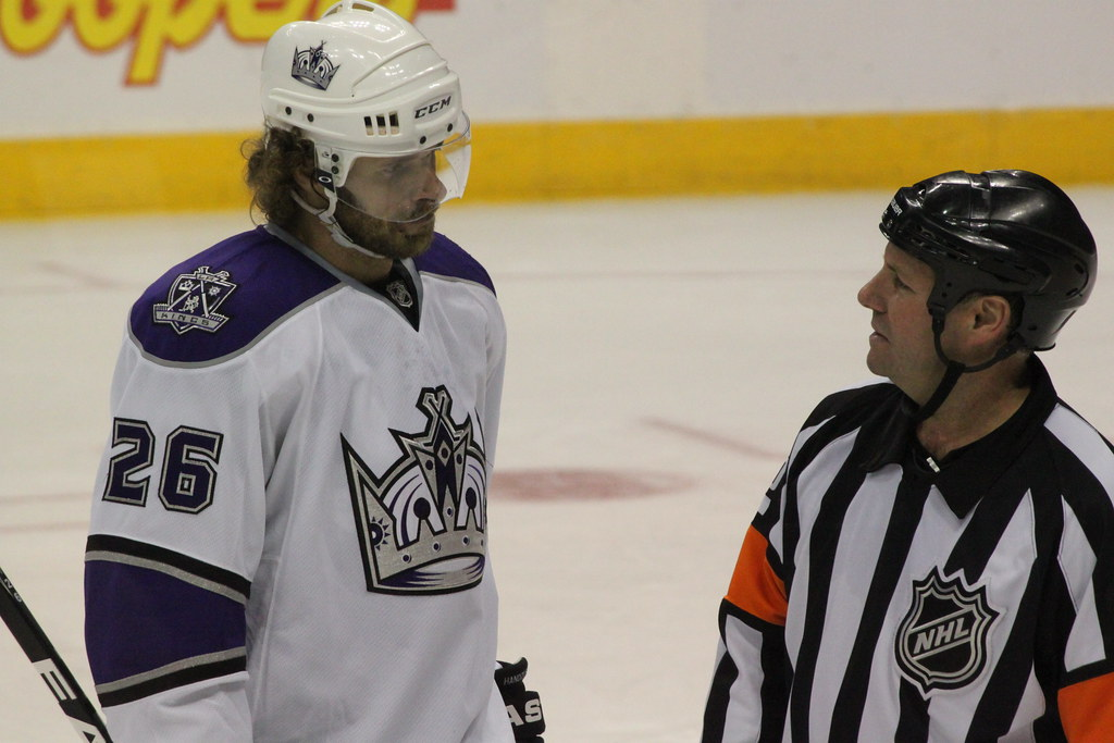 Michal Handzus (Kings) and referee Dan O'Rourke talking during the timeout