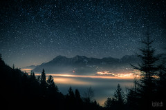 ~ Gonzen * Sea of fog ~ (dmkdmkdmk) Tags: trees sky mountains alps nature fog night clouds dark stars landscape lights switzerland swiss hdr lightpollution seaoffog gonzennebelmeer