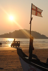 England flag flying on beach (amazing_tina) Tags: sunset sea water boat sand flag stgeorge boatview goabeach englandflag flagflying boatflag