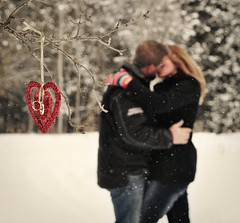 313/365 ~ LOVE ~ Take one... (Tina M89) Tags: winter snow love kissing bokeh marriage husband wife snowing redheart valentinesday mittens weddingbands commitment faithfulness embracing enduringlove project365 bokehhusbandandwifekissing hearthangingintree