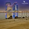 Dubai Crown Plaza|Vertoroma (vineetsuthan) Tags: plaza blue sky reflection building water architecture clouds paul lights nikon rocks dubai crown panoroma d300s vertoroma vineetsuthan vineetsuthancom