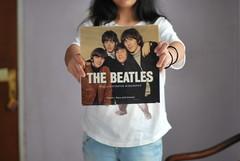 selteab eht (Bunga Atikha) Tags: girl 50mm book holding biography thebeatles nikond60 sooc