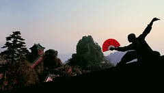 Kung fu at Wudang Mountain (Adam Peleg) Tags: china city sunset portrait mountain temple fan town asia fighter martialart chinese master kungfu warrior wushu wudangshan dao tao daoist hubei taoist ch monestary wudang