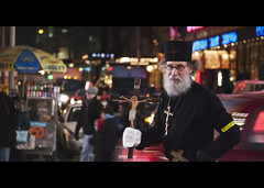 only in new york. (Vitaliy P.) Tags: street new york city nyc white motion black film car yellow night movie square stand moving high nikon bars hand cross shot traffic brother manhattan candid jesus monk line iso midtown tape gloves crop times gothamist priest soda cans bro held cart russian cinematic orthodox 800 pretzel vr nathanael 55200mm d80 brothernathanael vitaliyp bronathanael