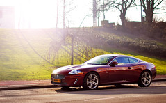 2009 Jaguar XKR (Thomas van Rooij) Tags: street city winter red sun sunlight cars netherlands car photography 50mm nikon glare thomas f14 14 arnhem profile nederland automotive spot exotic flare jaguar nikkor rare 2009 coupe supercar afs exotics supercars xkr xk d90 f14g rooij thomasvanrooij