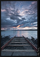 rapture express (terry wood Photography) Tags: sunset sea clouds rocks tracks rail auckland nz land poles onehunga sleepers singleraw terrywood nadinfinity