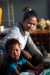 Unhappy Baby (Ursula in Aus (Away)) Tags: market laos morningmarket attapeu earthasia