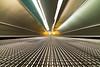 Faster! [Explored] (Aspiriini) Tags: longexposure london airport heathrow escalator lhr heathrowairport lentokenttä horizontalescalator jonilehto baaheathrow aspiriini conveyorbeltescalator hihnakuljetin