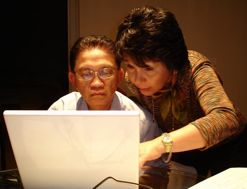 Chinese parents sitting before a laptop computer