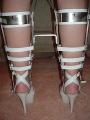 Rear Closeup of Braces with Straps and High Heeled Sandals (KAFOmaker) Tags: feet leather fetish foot high control legs braces lock sandals steel leg wrapped encased bondage device strap torso heel elk straight tight bound buckle locked brace restricted sandal joint buckles chained immobilized restraint restriction polio laced kafo restrained encase orthopedic imprisoned strapped heeled braced restrict buckled encircled immobilize tightly kneepad tlso tlso1