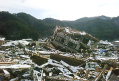 House turned upside-down by the force of tsunami (DFID - UK Department for International Development) Tags: urban rescue snow japan search earthquake destruction tsunami naturaldisaster humanitarianaid ukgovernment britishgovernment departmentforinternationaldevelopment dfid ukaid ukfireservice