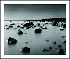 Shilling Hill (kittacabe) Tags: ireland sunset sea irish sun white seascape black beach canon landscape mono big rocks filter lee nd 24 70 graduated density stopper neutral 450d