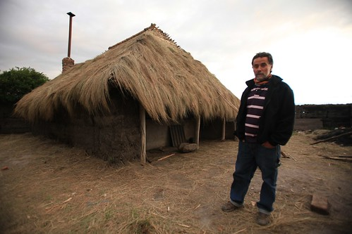 Rodrigo in front of his new hut.
