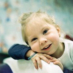 She's a Cutie-Pie... (christian.senger) Tags: travel family blue portrait white cute texture 6x6 film girl smile face rollei analog rolleiflex mediumformat turkey geotagged kid eyes toddler asia soft dof child hand kodak availablelight fingers indoor niece squareformat sl66 portra lightroom denizli carlzeiss silverfast photostudio13 christiansenger:year=2011